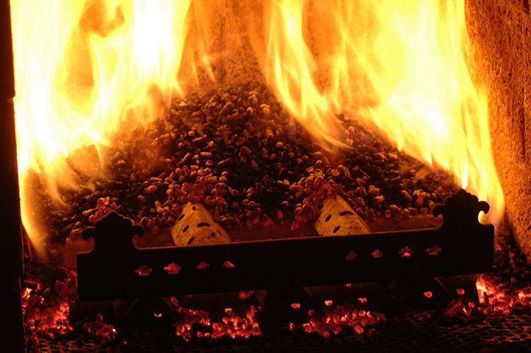 a picture of biomass pellets burning in the combustion chamber